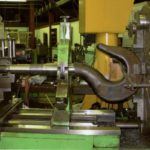 Machining the overhead cable hook forging